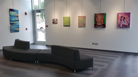 Art Gallery Nook with seating and art work displayed